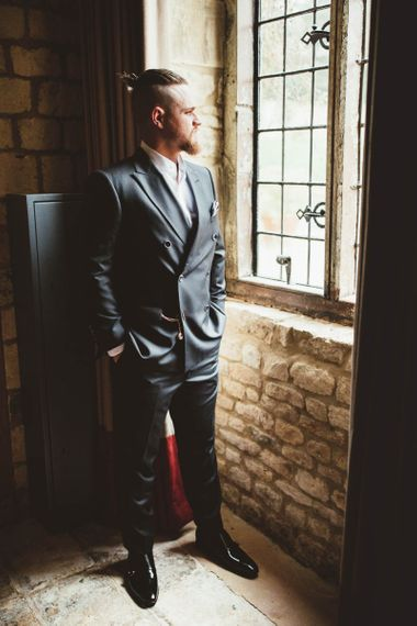 Groom in Reiss Suit Standing by The Window