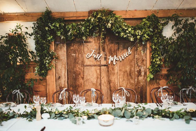 Top Table Back Drop Greenery Floral Arrangement with Copper Just Married Bunting