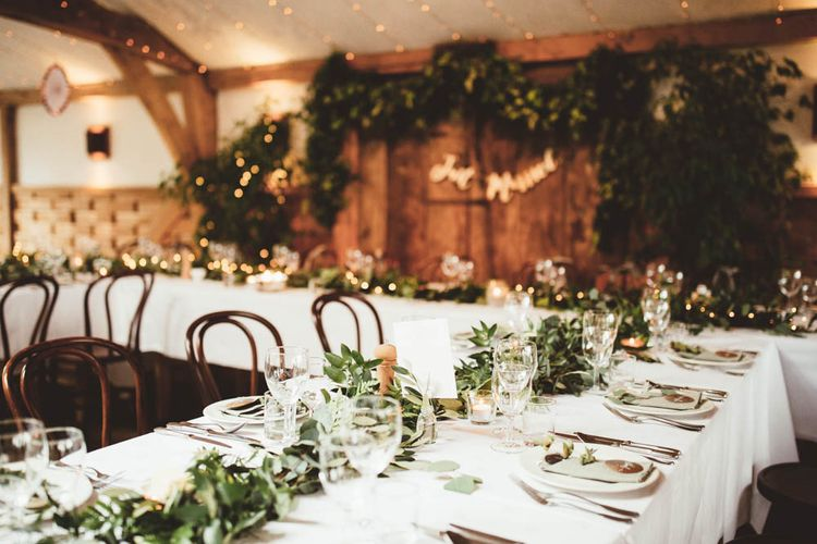 Wedding Reception Decor with Greenery Table Runner and Top Table Back Drop with Copper Just Married Bunting
