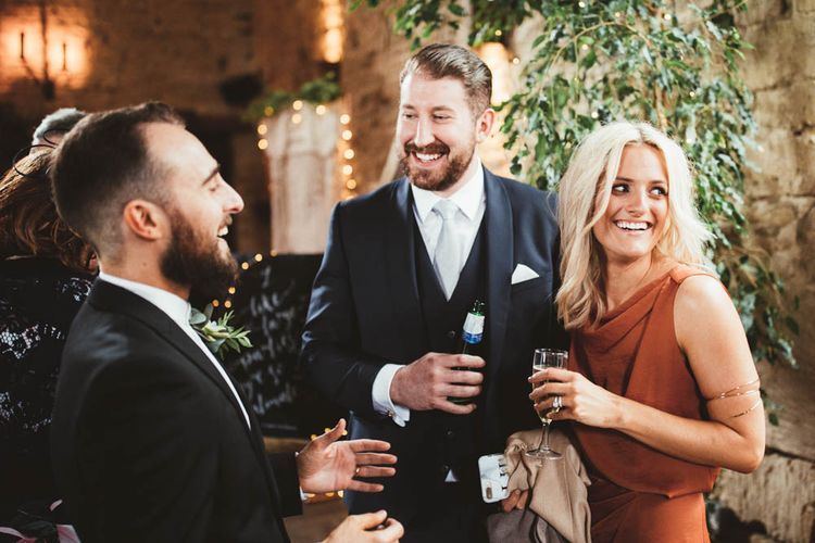 Wedding Guests Laughing Together