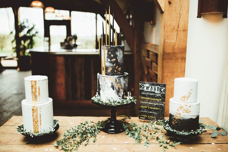 Three Celestial Wedding Cakes with Monochrome and Gold Decor and Tall Candles