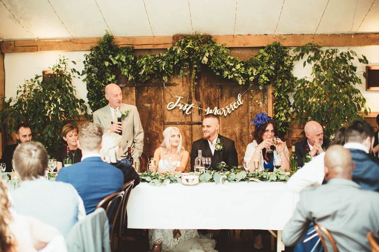Top Table Greenery Back Drop and Copper Just Married Bunting