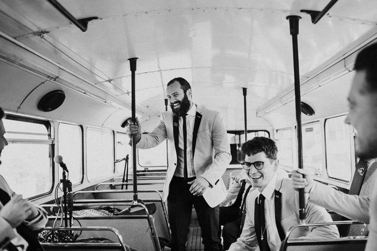 Groomsmen on London Double Decker Bus