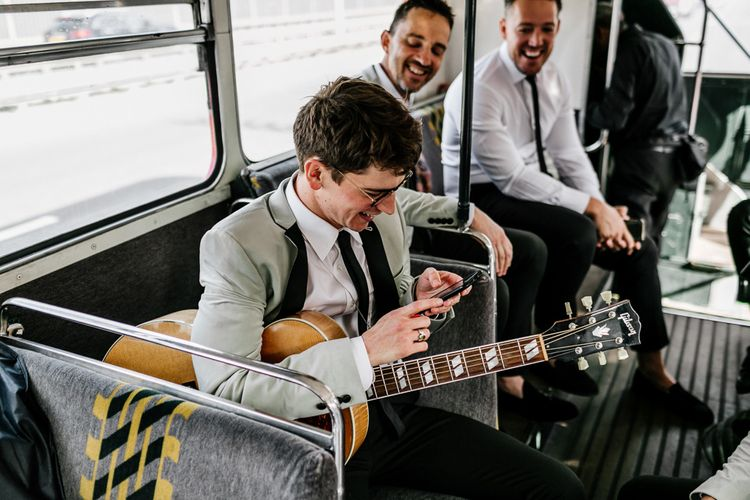 Groomsman Playing Guitar on a London Double Decker Bus