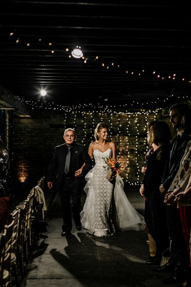 Bride Walking Down the Aisle in Lace Applique Tara Keely Wedding Dress
