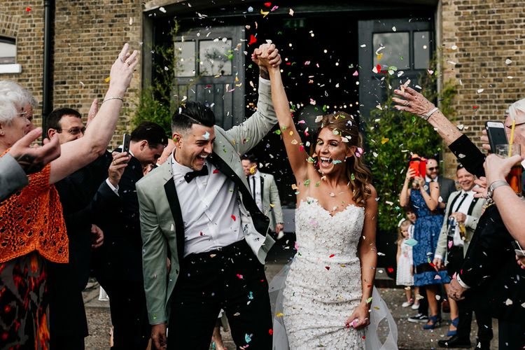 Confetti Moment with Bride in Tara Keely Wedding Dress and Groom in Grey Tuxedo Jacket