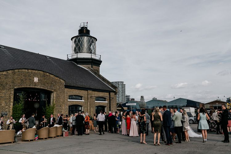 Wedding Guests Outside Trinity Buoy Wharf London Wedding Venue