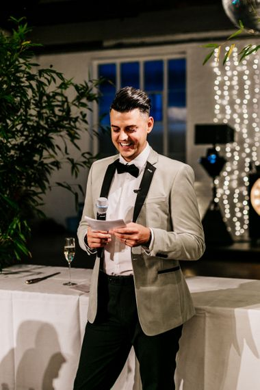 Stylish Groom in Black Trousers and Grey Tuxedo Jacket Giving His Wedding Speech