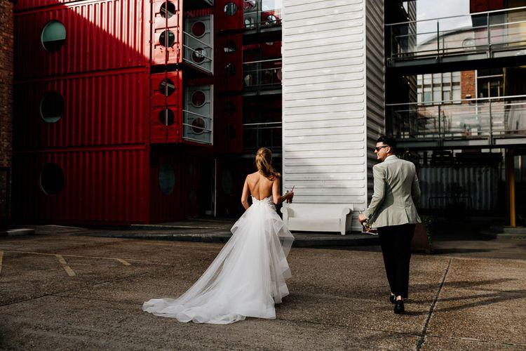 Bride in Tara Keely Applique Wedding Dress and Groom in Grey Tuxedo Jacket