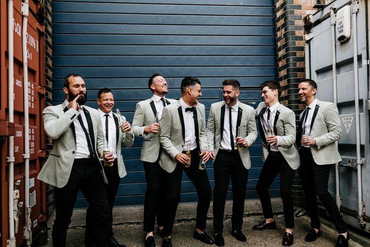 Stylish Groomsmen in Black Trousers with Grey Tuxedo Waistcoats