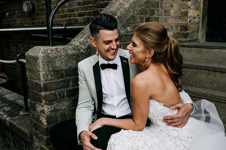 Stylish Bride and Groom Embracing