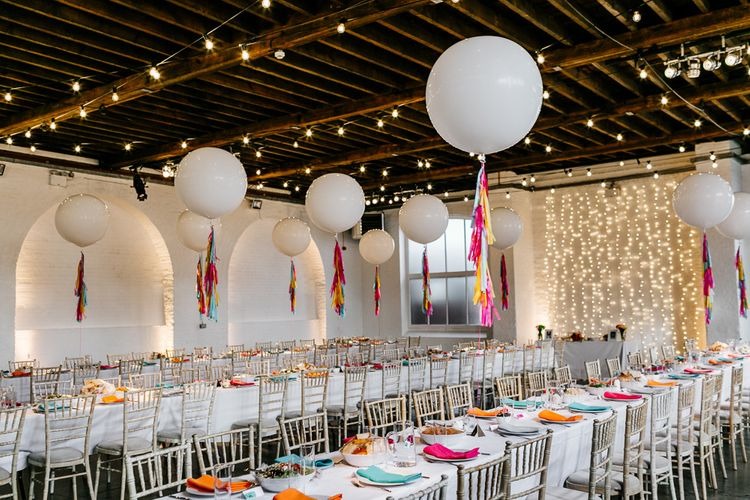 Trinity Buoy Wharf Warehouse Wedding with Giant Balloons with Colourful Tassels Wedding Decor