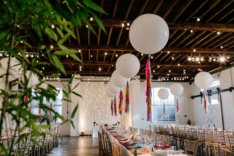 Bright Wedding Decor with Coloured Napkins and Tissue Tassels on Giant Balloons