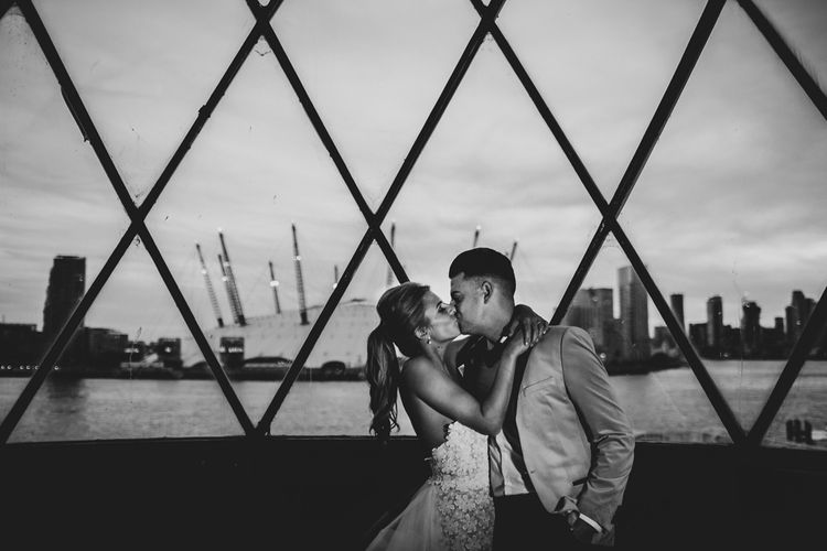 Bride and Groom Kissing in Front of the O2 Arena in London
