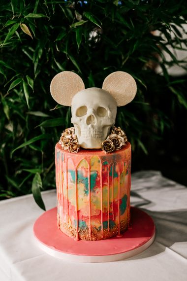 Colourful Drip Wedding Cake with Skull and Minnie Mouse Ears Cake Topper