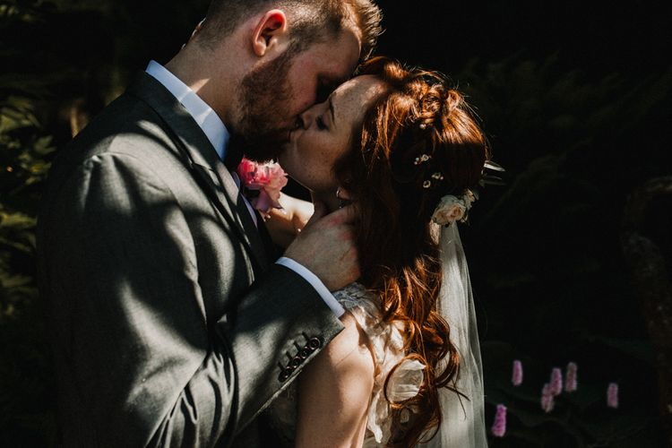 Bride in  Appliqué Flowers Yolan Cris 'Espino' Wedding Dress | Groom in Grey's Suit Hire | Pre-Raphaelite Mood Wedding at Heaver Castle in Kent | Carla Blain Photography