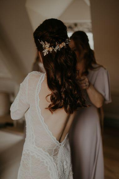 Half up half down wedding hair with floral headdress