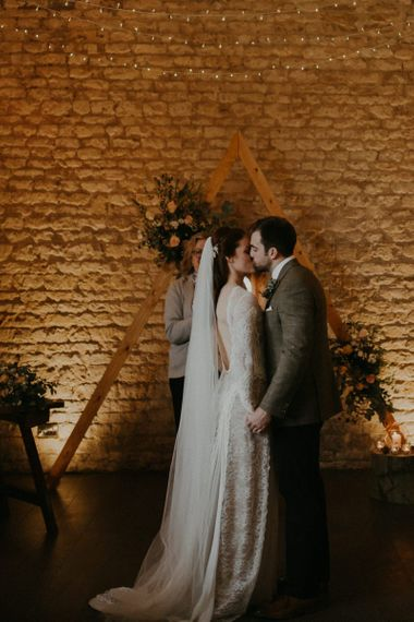 Bride and groom kissing at Lapstone Barn wedding ceremony