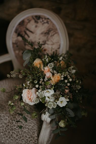 Peach and white flower wedding bouquet with foliage