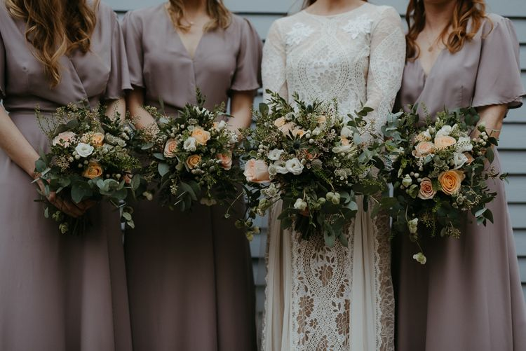 Peach and white flower bouquets with foliage
