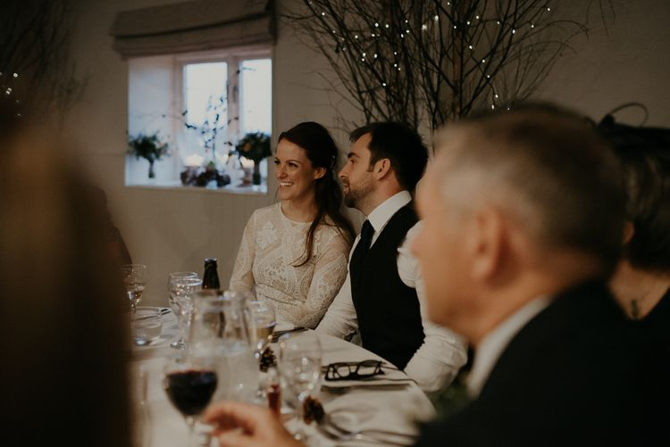 Bride and groom smiling during Lapstone Barn wedding reception