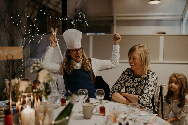 Wedding guest wearing chefs hat during wedding breakfast