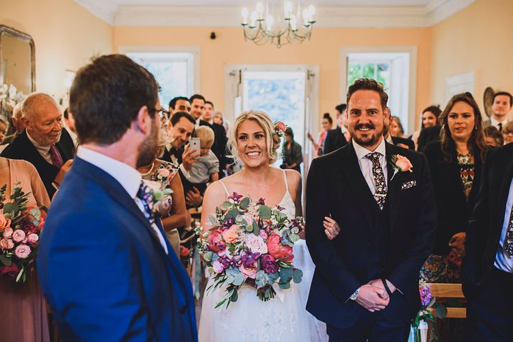 Bridal Entrance in MiaMia Spagetti Strap Bridal Gown   DIY Bright Family Wedding at Plas Glansevin in Carmarthenshire, Wales    O& C Photography