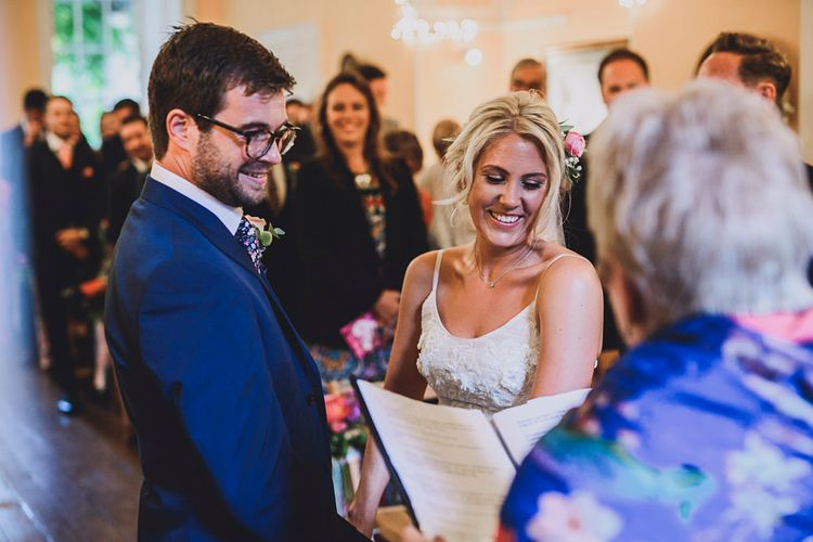 Wedding Ceremony   Bride in MiaMia Spagetti Strap Bridal Gown   Groom in Next 3-piece Suit   DIY Bright Family Wedding at Plas Glansevin in Carmarthenshire, Wales    O& C Photography