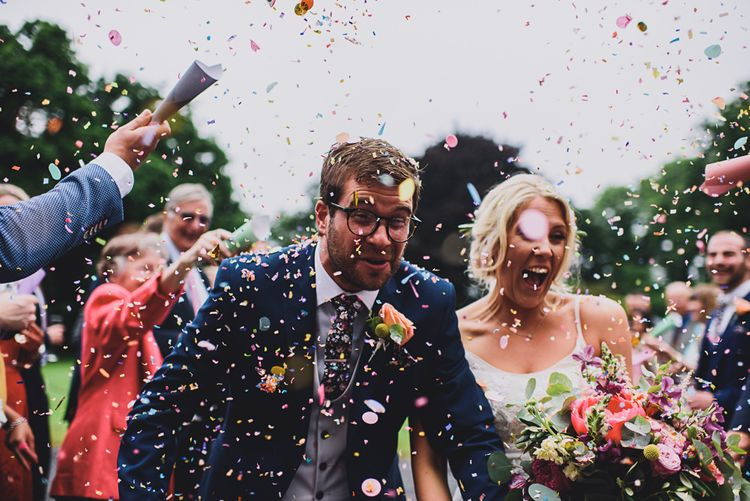 Confetti Moment   Bride in MiaMia Spagetti Strap Bridal Gown   Groom in Next 3-piece Suit   DIY Bright Family Wedding at Plas Glansevin in Carmarthenshire, Wales    O& C Photography