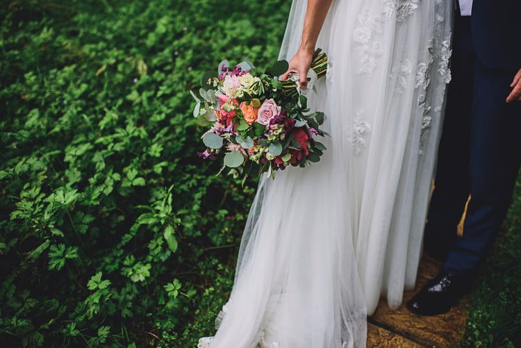 Colourful Bridal Bouquet   Bride in MiaMia Spagetti Strap Bridal Gown   Groom in Next 3-piece Suit   DIY Bright Family Wedding at Plas Glansevin in Carmarthenshire, Wales    O& C Photography