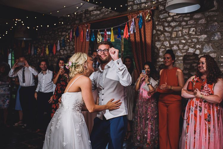 First Dance   Bride in MiaMia Spagetti Strap Bridal Gown   Groom in Next 3-piece Suit   DIY Bright Family Wedding at Plas Glansevin in Carmarthenshire, Wales    O& C Photography