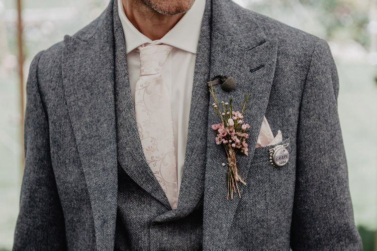 Grey wooden suit for wedding with Prosecco wall