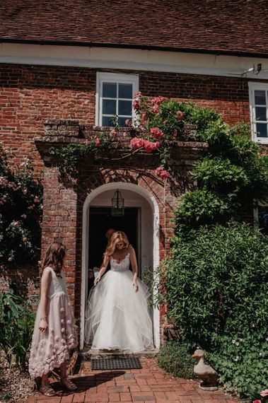 Bride makes her way to ceremony in Hayley Paige wedding dress