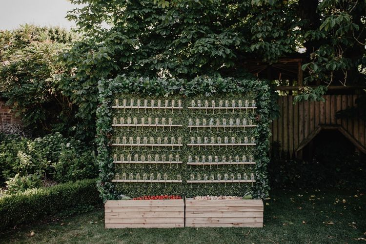 Prosecco wall at outdoor wedding