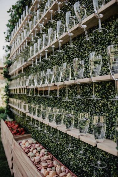 Prosecco wall at outside wedding with marquee and garden games