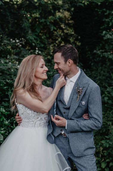 Bride and groom in grey waistcoat and jacket