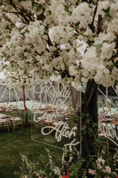 Cherry blossom wedding decor with acrylic neon signs