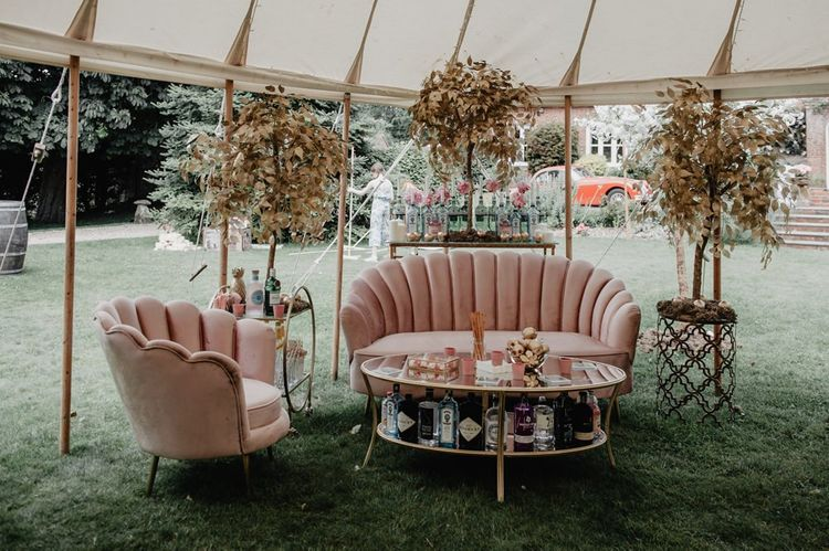 Pink sofa seating area with cherry blossom decor