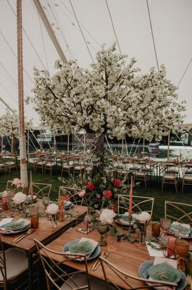 Stunning marquee wedding decor with cherry blossom
