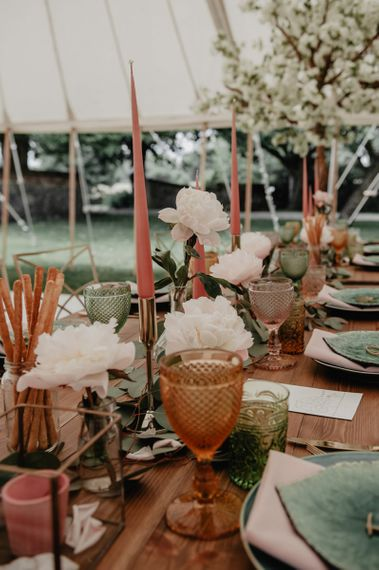 Wedding table decor with blush flowers and candles