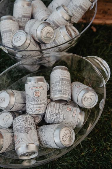 Personalised cans of beer and Prosecco wall at wedding