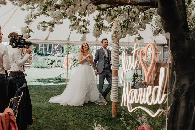 Just married neon wedding sign and Prosecco wall