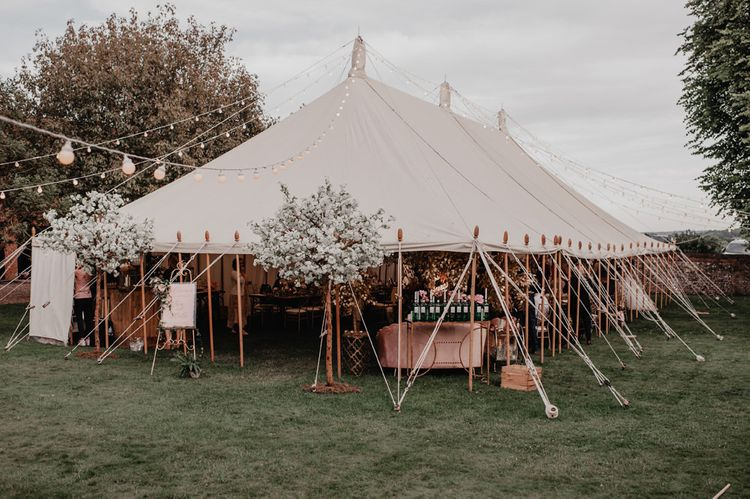 Wedding marquee in garden with cherry blossom trees