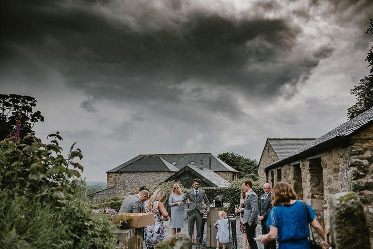 Wedding Guests Gathering Outside Trevenna Barn Cornwall Wedding Venue