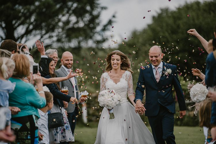 Classic Bride and Groom Having Confetti Thrown Over Them
