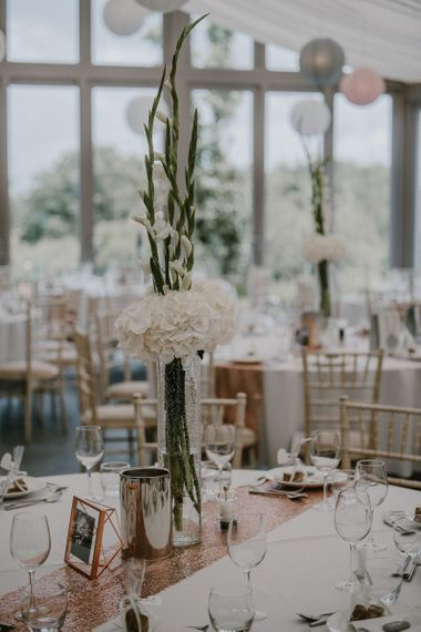 Tall White Hydrangea & Stocks Flower Centrepiece on a Sequin Table Runner