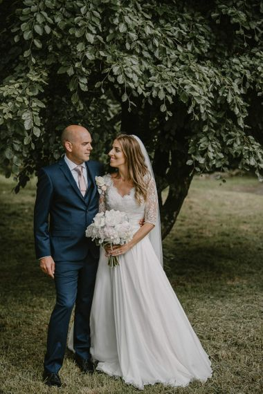 Classic Bride and Groom with Bride in Naomi Neoh Wedding Dress and Groom in Blue Ted Baker Suit