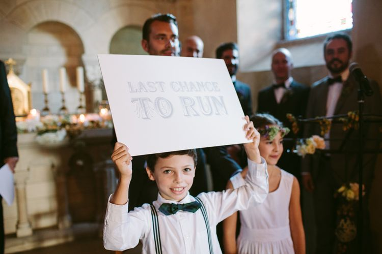 Page Boy with Last Chance to Run Wedding Sign | Stylish Two Day Wedding at Château de Varennes, Burgundy, France with I Do BBQ After Party Planned by Bulle & Tulle | Troistudios Photography | Studio80  Film