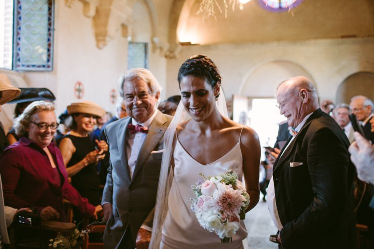Church Ceremony | Bridal Entrance in Delphine Manivet Bridal Separates | Stylish Two Day Wedding at Château de Varennes, Burgundy, France with I Do BBQ After Party Planned by Bulle & Tulle | Troistudios Photography | Studio80  Film
