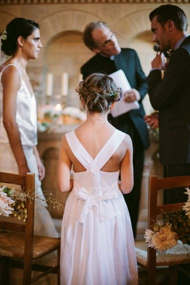 Church Ceremony | Flower Girl | Stylish Two Day Wedding at Château de Varennes, Burgundy, France with I Do BBQ After Party Planned by Bulle & Tulle | Troistudios Photography | Studio80  Film